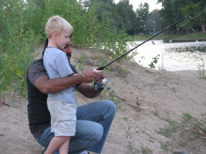 Naren showing Gavin how to fish.